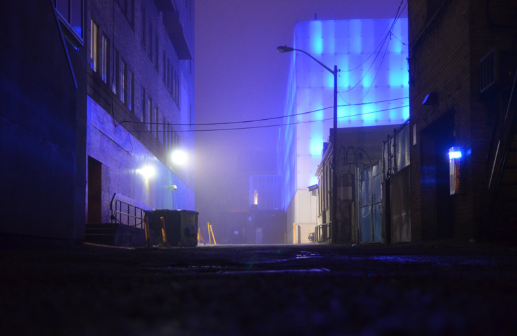 bluish glow on a foggy night the blue colour is from the lights on